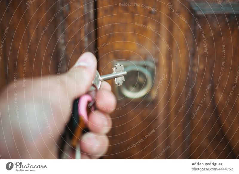 Door of a rural hotel room, with the key in the lock. access apartment door entrance estate hosting housing inside no people open privacy rent secure interior