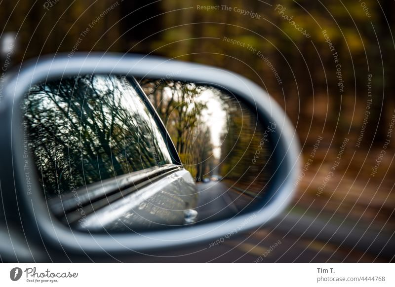 an autumn country road in the rear view mirror of the car Autumn Rear view mirror Country road Colour photo Street Car Deserted Transport Exterior shot