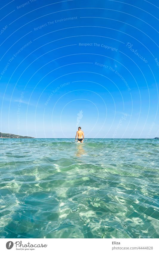 Man in the sea Ocean bathe vacation horizon Swimming & Bathing Vacation & Travel Blue Sky Water Summer Summer vacation clear