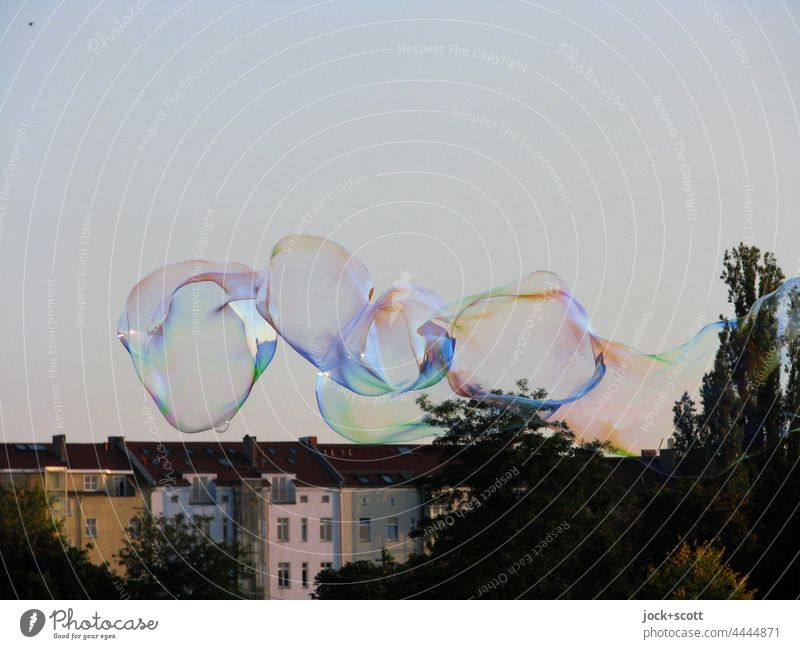 Soap bubbles in Mauerpark Light heartedness Weightlessness short-lived Transformation Hover Ease Neutral Background Cloudless sky Street art Glittering