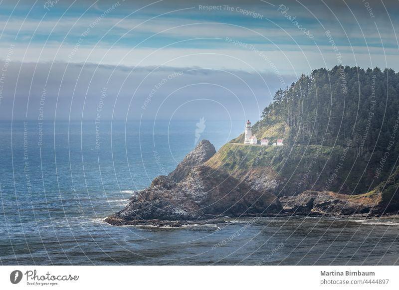 The historic Heceta Head Lighthouse, Florence Oregon USA oregon tourism heceta shore ocean lighthouse coast landscape travel beacon water pacific sky
