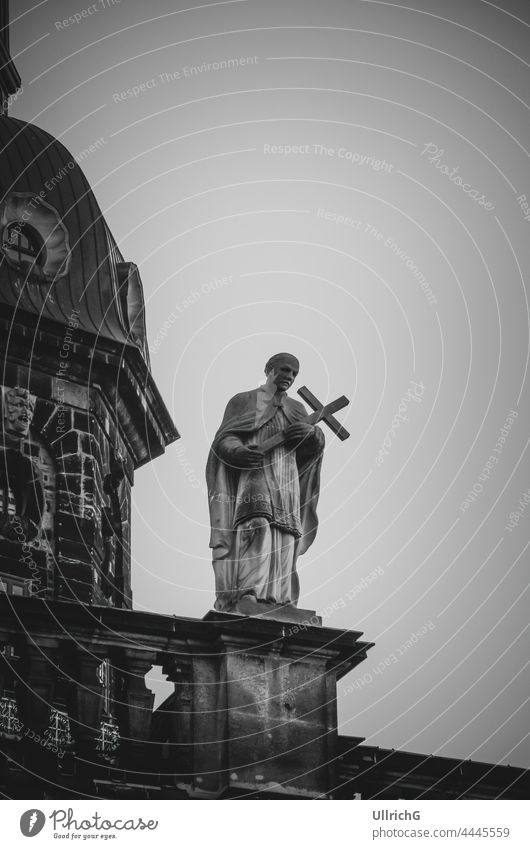 """Dresden, Saxony, Germany: One of the so-called Mattielli statues on the outer balustrade of the Hofkirche ("""" Cathedral""""); this is Raimund of Penyafort, the Master of the Dominican Order and patron saint of the canons."""