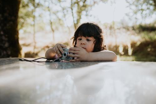 Cute girl playing with digital camera Child childhood Girl Playing Digital Camera Photography little happy fun lifestyle kid cute Technology Digital camera