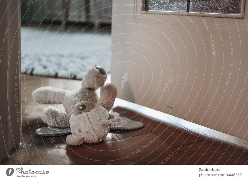 Teddy bear lies in half open door to children's room Toys Children's room Lie Infancy Fear Abuse material Sadness sad Loneliness Grief Tidy up disorder
