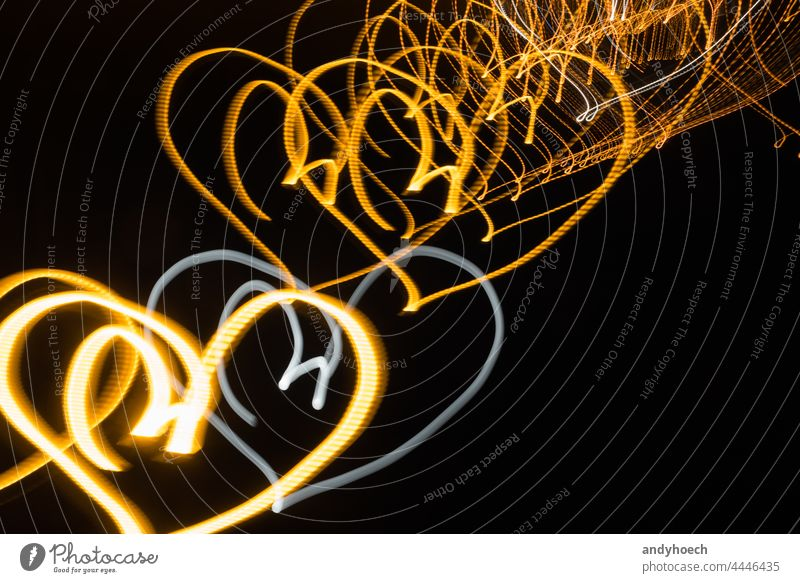 Neon hearts on black background at night abstract bright celebration color copy space creativity curve dark decoration decorative design effect electric energy