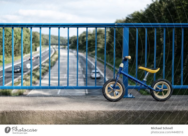 Old wheel on a bridge over the highway impeller Child Infancy Exterior shot Movement Toddler Bicycle Playing Former Past Review Longing melancholically