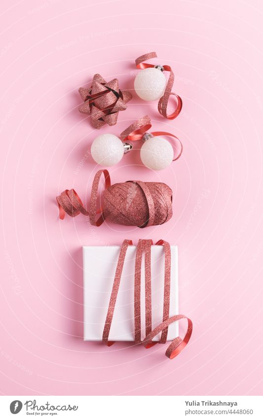 Christmas card made of festive decorations on pink background. christmas pastel wrapping gift flatlay giftbox layout greeting present greeting card xmas fashion