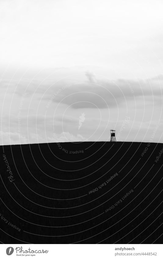 The high seat on a hill in the field abstract Art beautiful black black and white BW clouds contrast copy space day deer stand design environment european fauna