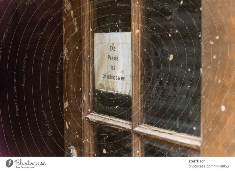"""Improvised """"practice closed"""" sign in a window of a wooden door after the flood in the Ahr valley Day Entrance Window Medical practice Doctor medical practice"""