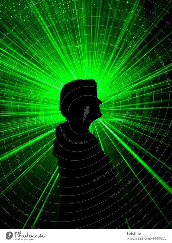 There shines the Fotolie between all the laser beams in an old Lost Place. Laser Laser show Light Night Dark Long exposure Colour Green darkness Illuminate rays
