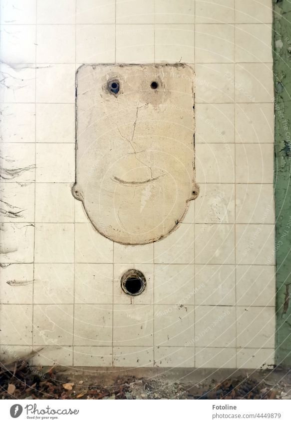 Lost Place - In the tiles a face is silhouetted, smiling at me. Dirt and cobwebs are completely forgotten. lost place forsake sb./sth. Broken Old Derelict