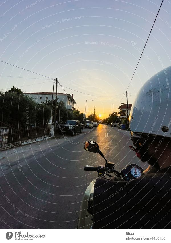 A man in a helmet rides a quad bike towards the sunset Sunset Adventure Driving Man Quad Freedom Summer Helmet Street motorized Vehicle Place Trip