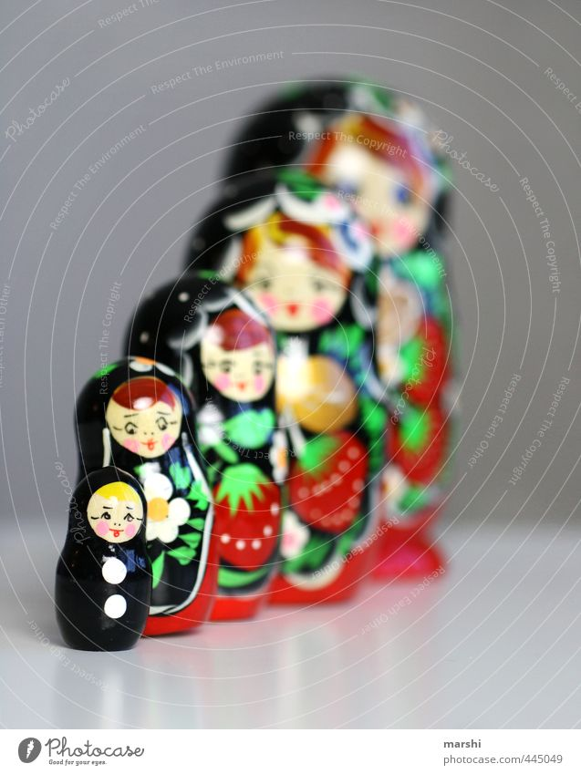 When I grow up, I'll be a matrioshka. Leisure and hobbies Playing Wood Red Black Matryoshka Doll Russia Shallow depth of field Small Decoration Row Colour photo