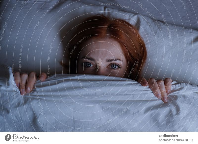 sleepless woman lying in bed hiding under duvet at night hide terror nightmare girl cover insomnia face tired person frustration noise anxiety stress depression