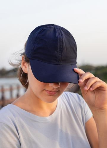 Teen girl in dark blue baseball cap and t-shirt outdoor teenager adolescent Caucasian mockup sea visor wearing t-shirts teen girl childhood female happiness