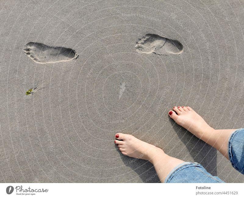 Barefoot tracks in the sand on the beach footprint Footprint footprints Tracks Exterior shot Day Deserted Gray beach sand daylight Detail detail detailed feet