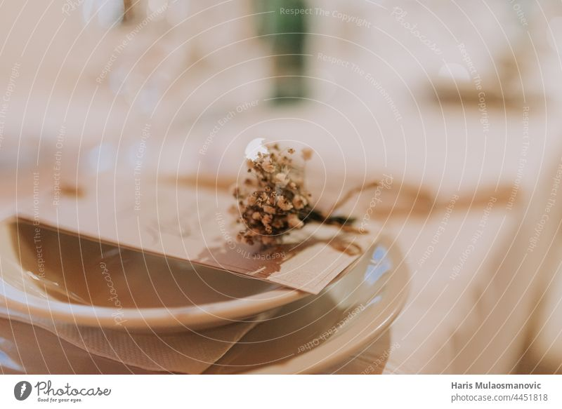 selective focus on wedding details on the table at restaurant accessory background beautiful beauty beige bloom blossom bouquet bridal bride brown celebration