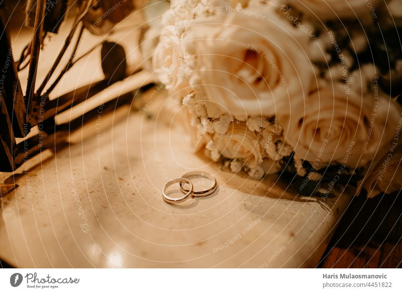 wedding rings and bouquet low light atmosphere background beautiful beauty bridal brown celebration ceremony closeup couple decoration design engagement event