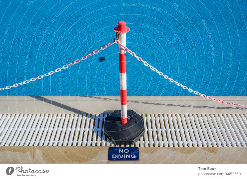 """Barrier at the edge of a swimming pool """"no Diving Fence cordon barrier tape Chain Red White do not jump Water Safety vacation Reddish white Protection"""