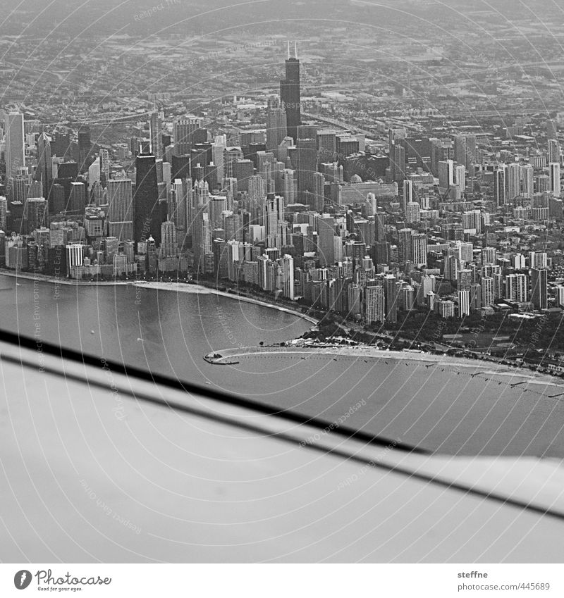 Approaching: Chicago USA Downtown Skyline High-rise Aviation Airplane Airplane landing Airplane takeoff View from the airplane Town Black & white photo
