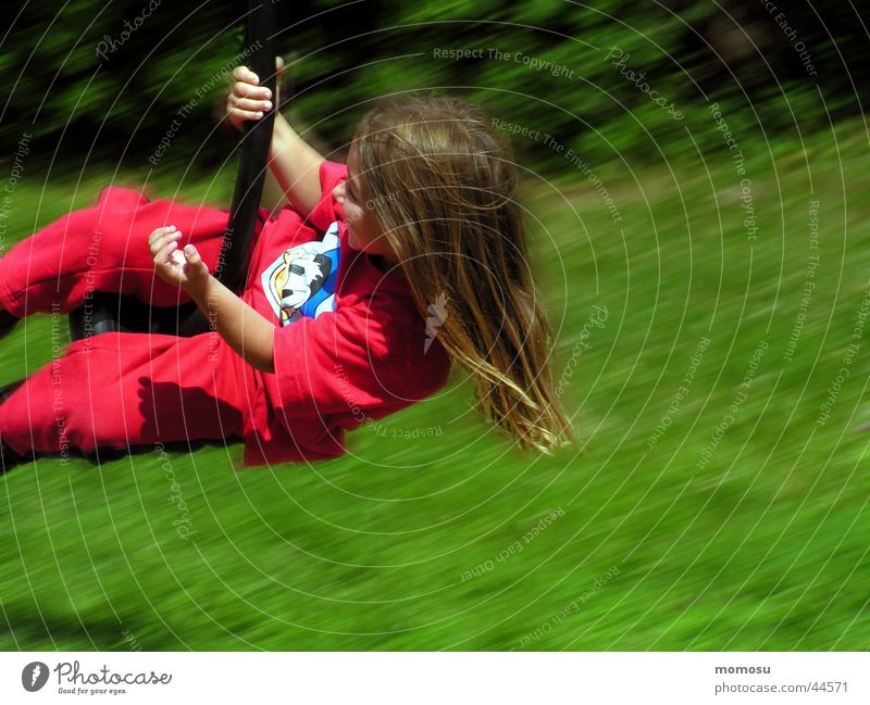 flight through the green Child Girl Playground Grass Meadow Red Green Aviation fun Movement Hair and hairstyles