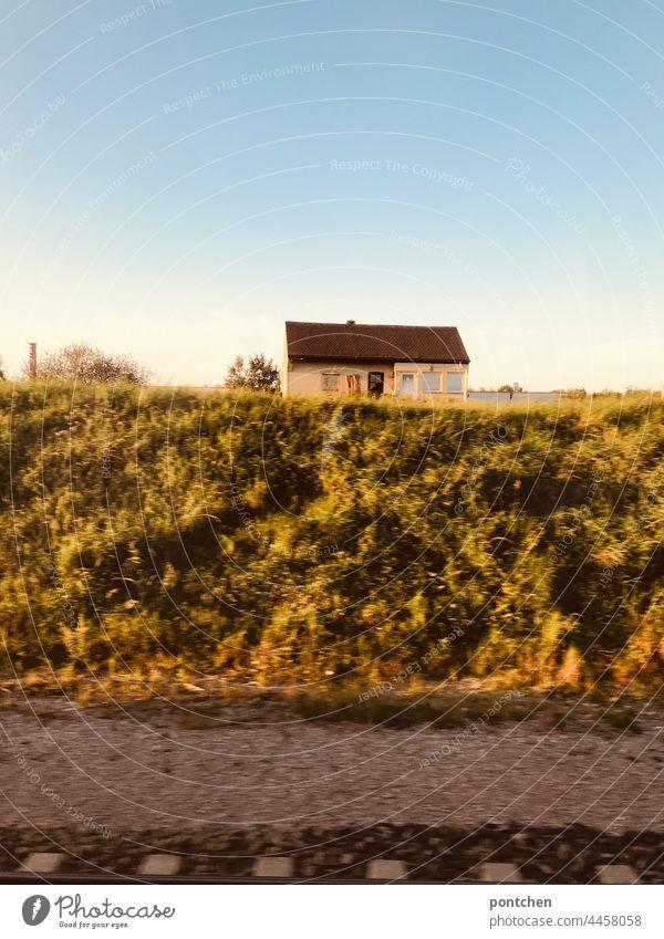 View from the train. Golden autumn. A small old house on the track train ride Autumn Sun golden autumn rail gleiß Landscape forsake sb./sth. public transport