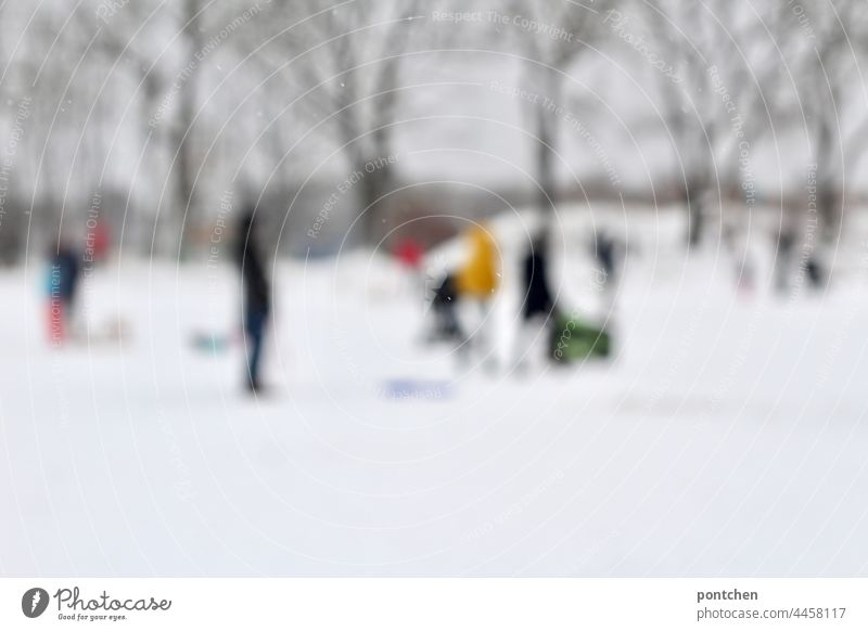 blurred people at the sledding hill. Winter blurriness sledging hill Infancy Snow winter landscape