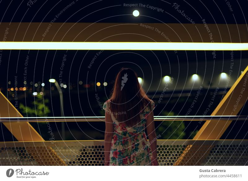 Woman from behind looking at night, the lights of the city and the moon. Night Night shot Moon Light and shadow Night sky Exterior shot Dark Moonlight