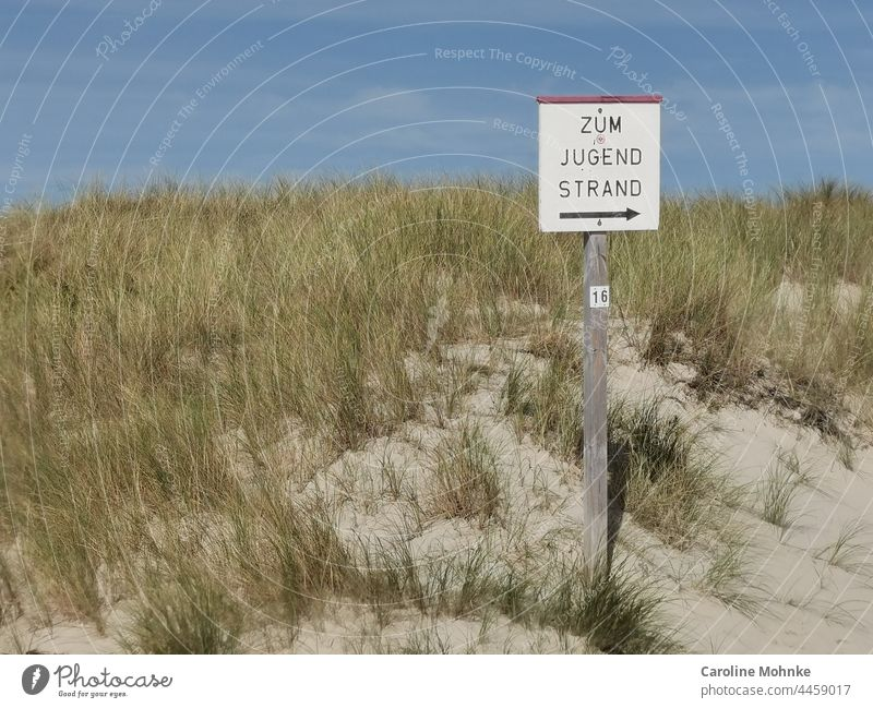 """Sign """"To the Youth Beach Ocean Sand Water Waves coast Sky Clouds Blue Horizon Landscape Exterior shot Deserted Colour photo Nature Day Vacation & Travel"""