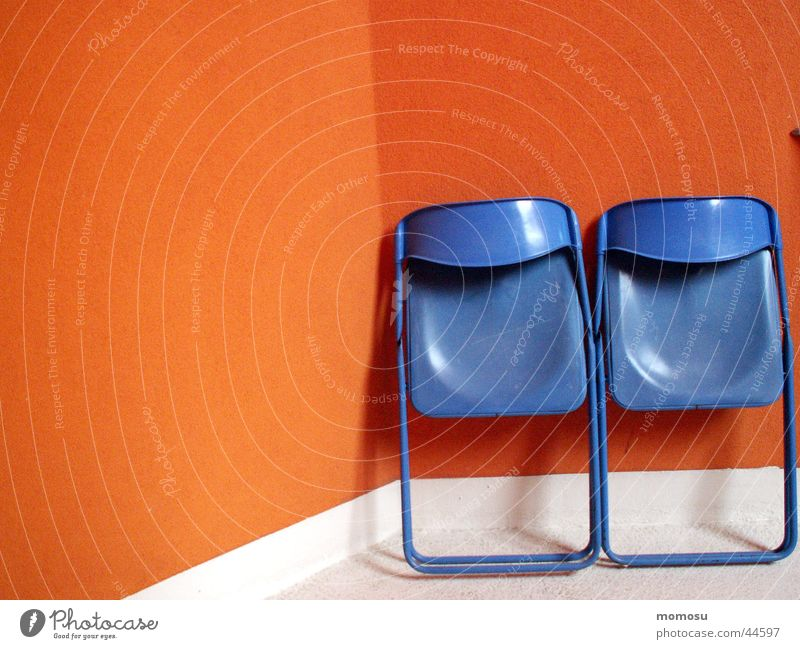 Blue Wall (building) Wall (barrier) Orange Facade Chair Living or residing Camping chair