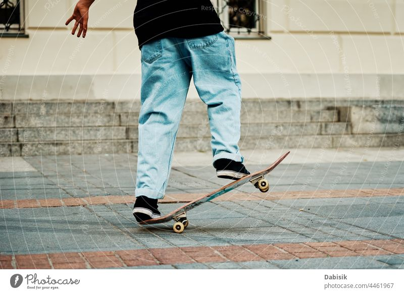 Skateboarder ride on skateboard at city street, close up skater sport boy hipster sneakers young shoes casual freestyle male streetwear action extreme fashion