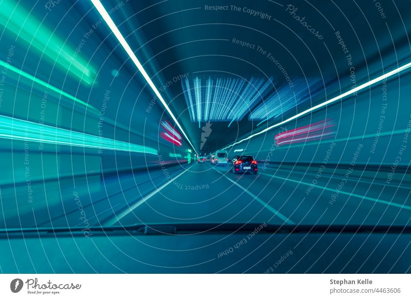 Highspeed drive through a underground tunnel from the car drivers view. almost technology way road concept movement color automobiles transportation line