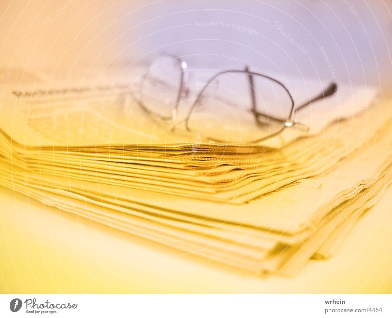 newspaper Eyeglasses Newspaper Yellow Photographic technology Blue Business
