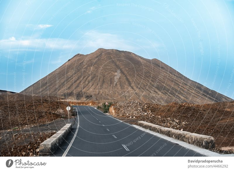 Empty highway and mountain against blue sky road landscape travel trip journey santo antao cape verde cabo verde africa scenery deserted picturesque tranquil