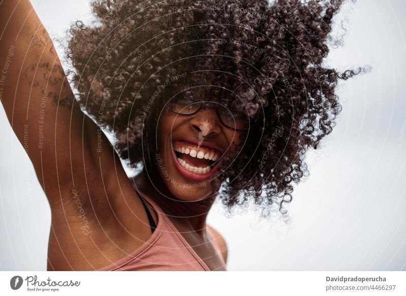 Happy ethnic female with curly hair woman happy african american hairstyle wild joy santo antao cape verde cabo verde young laugh excited joyful cheerful