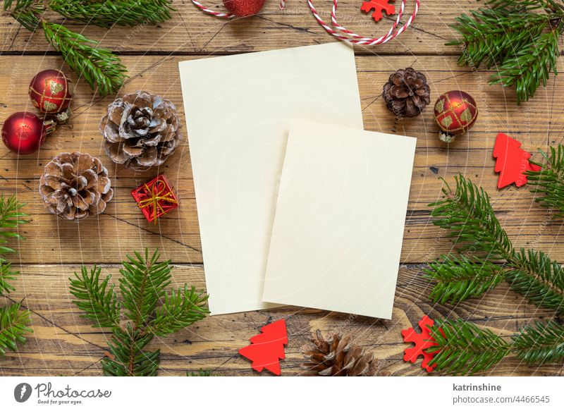 Christmas Composition with a blank cards over wooden table flat lay christmas mockup holiday New year fir template winter paper greeting white decoration