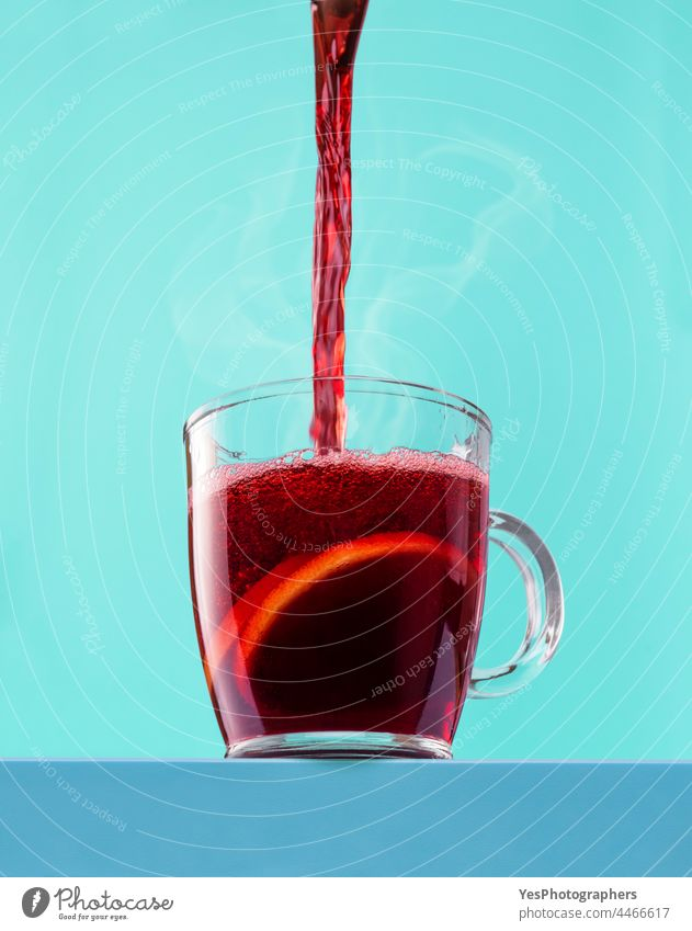 Pouring hot mulled wine into the cup. Hot red wine in a glass mug. advent alcohol angle aroma autumn background beverage blue celebration christmas close-up
