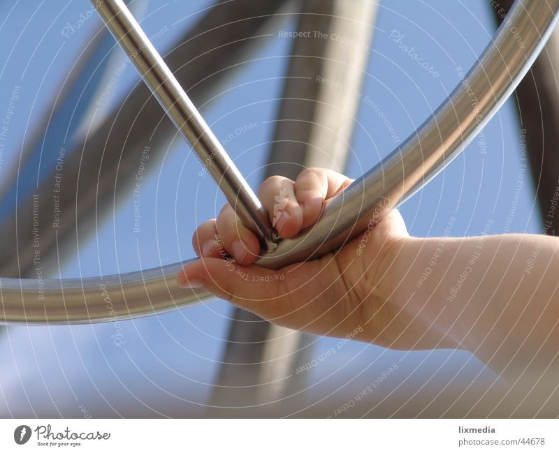 hand at the wheel Hand Steering wheel Conduct Child Playground Leisure and hobbies Above Sky