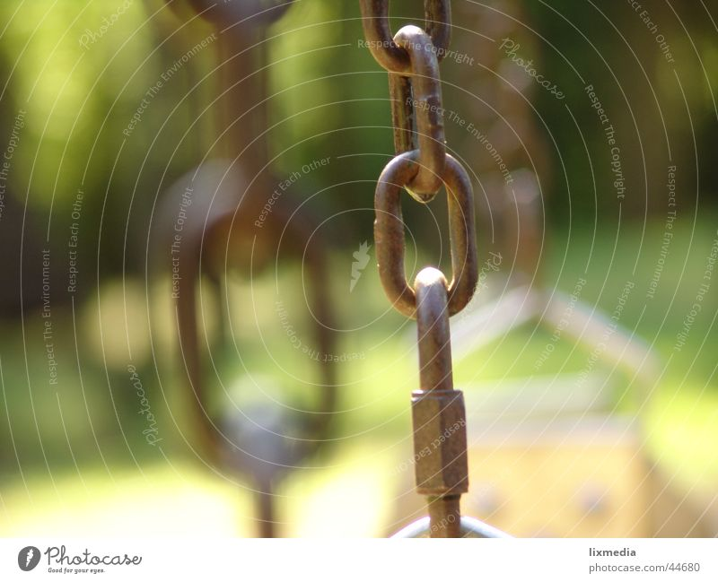 swing chain Leisure and hobbies Playground Brown Yellow Green Swing Chain link Swing chain Depth of field Detail Blur