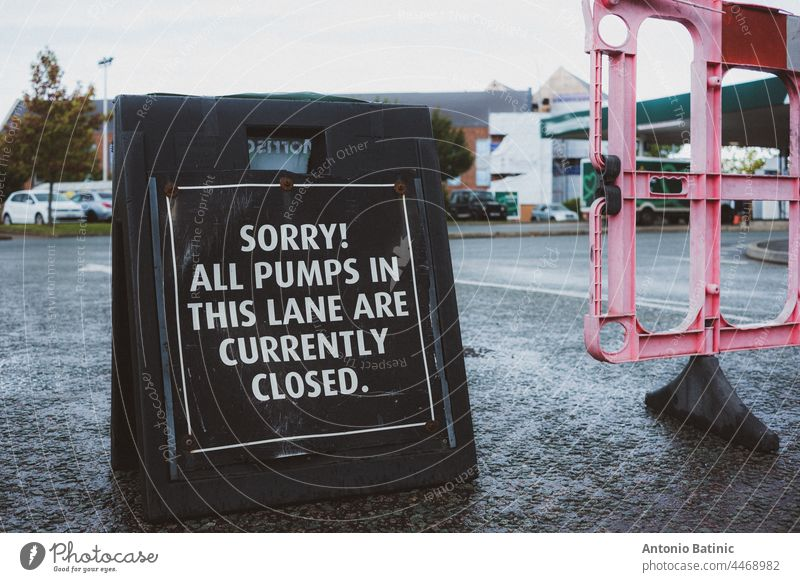 Black sign in front of a fuel station in England. Petrol crysis as there is fuel shortage in the country, people queueing up at petrol stations to get any fuel remaining
