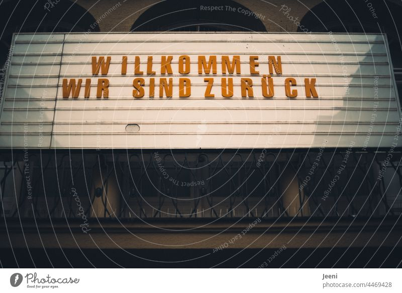 Welcome - we are back Backward Characters writing Berlin Neukölln Cinema passage Word Typography Colour photo Text Letters (alphabet) Signs and labeling