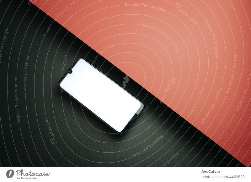 Top view of mobile phone screen blank template on black and red background with copy space, minimal design, shapes, colorful background, young style , transgender flag,