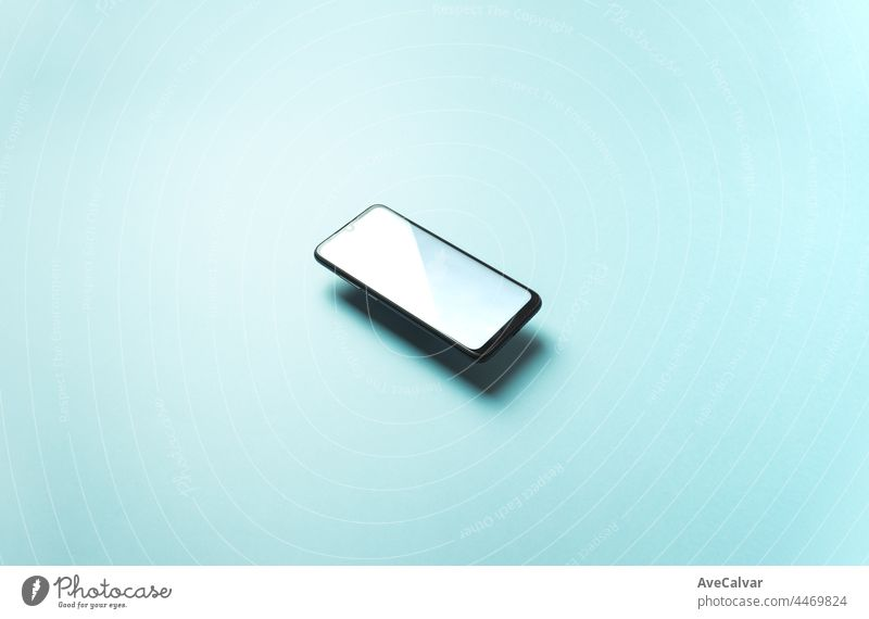 Top view of mobile phone floating blank scree template on pastel pastel blue background with copy space, minimal design, shapes, colorful b colours screen smart