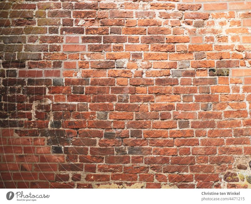 constructive   stone on stone Brick facade Brick wall Bricks Old Facade Wall (barrier) Wall (building) repaired Red Stone Structures and shapes Building vintage