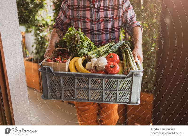 Man delivering fruit and vegetable box adult buying cooking coronavirus courier delivery delivery box delivery man diet door food fresh fresh food freshness