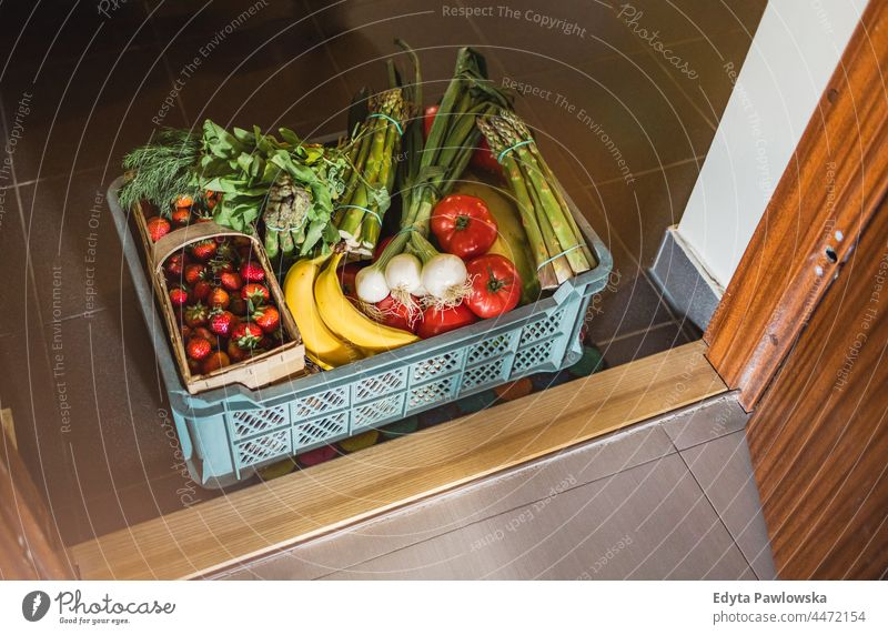 Fruit and Vegetable delivery box in front of a door to the flat asparagus basket buying cooking coronavirus courier delicious diet food fresh fresh food
