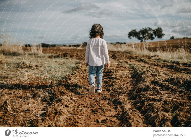 Rear view girl walking on plowed path Child Girl Walking 1 - 3 years Caucasian one person Plowed pathway the way forward Human being Colour photo female people