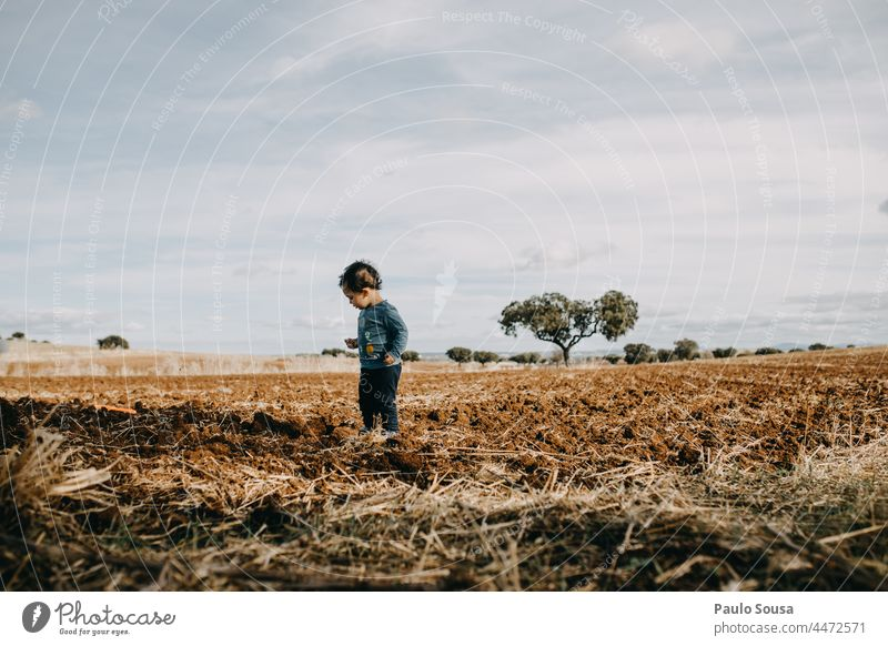 Child standind on plowed field Plowed childhood Authentic Caucasian 1 - 3 years one person Lifestyle Colour photo Infancy Human being Joy Happy