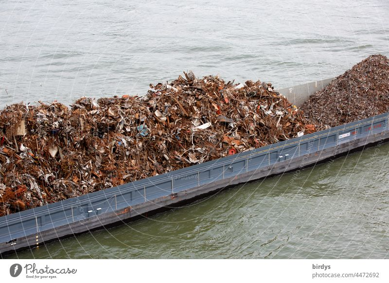 An inland vessel loaded with scrap and scrap metal Scrap metal Metal recycling resource Recycling ship Cargo Navigation Transport Logistics Water