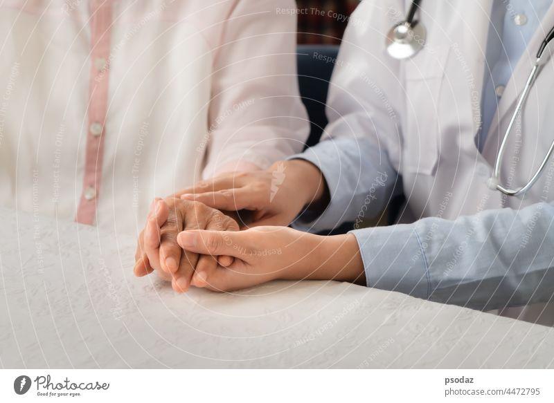 Doctor hands together holding senior woman patient addiction adult aged aid assistance care caucasian closeup communication compassion concept conceptual